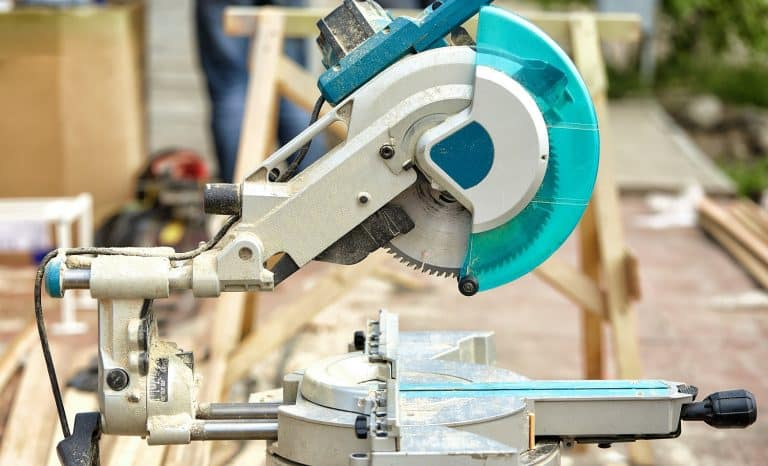 Close-up of a laser circular saw at a construction site. Products for home and garden and production. Building tool