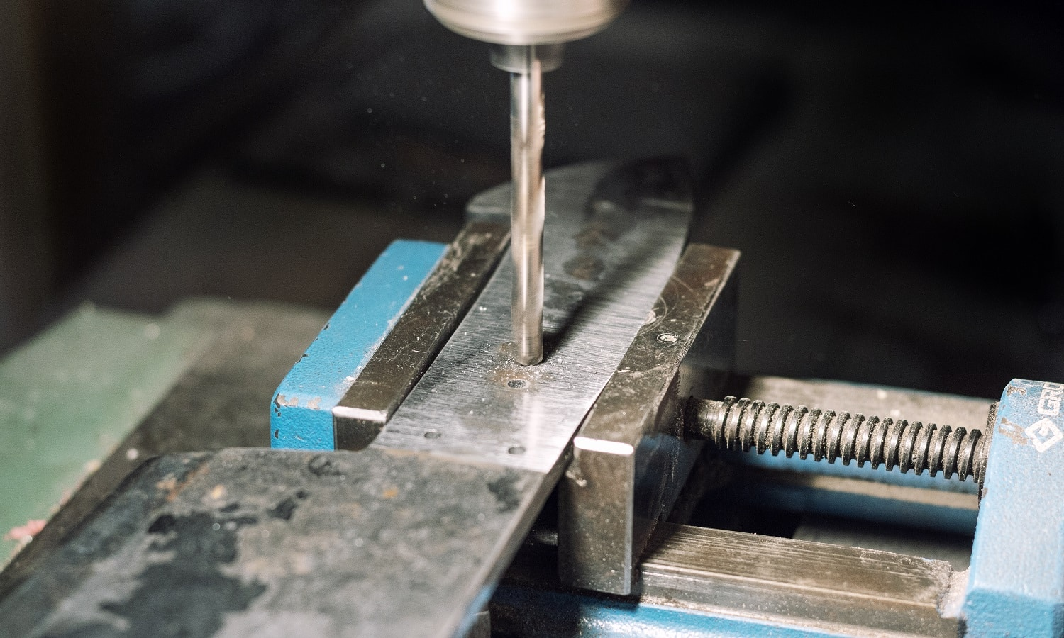 Drilling holes in a metal knife handle