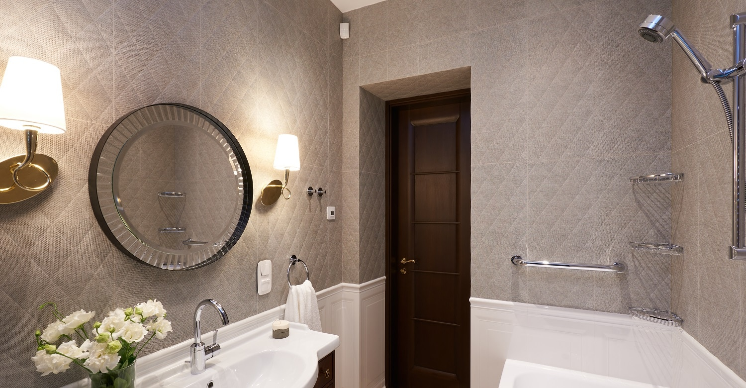 Modern Bathroom interior with stone wall, mirror and shower. Real photo.