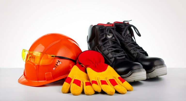 Protective helmet, boots, gloves and glasses. Standard construction safety.