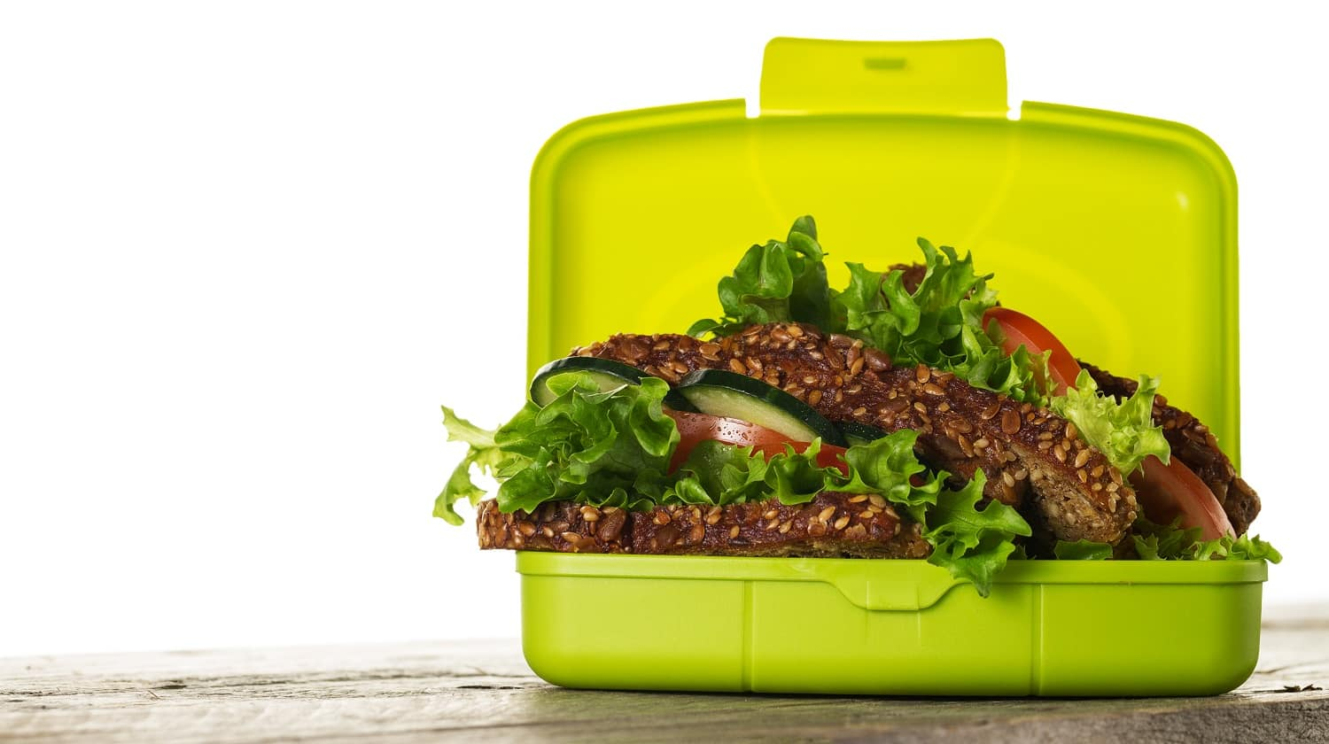 Tasty Healthy Vegetarian Vegan Sandwich in Lunch Box on Wooden Table on White Isolated Background. Horizontal. Copy Space.