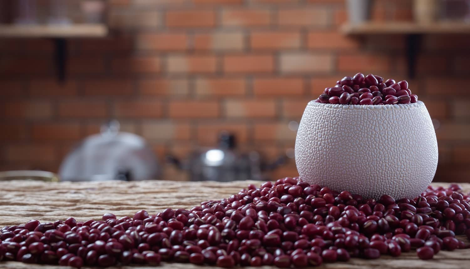 Red bean seeds on a wooden background in the kitchen