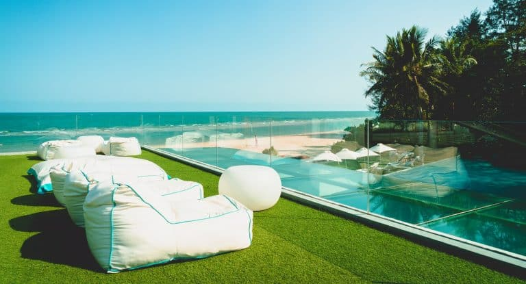 empty beach bean bag on balcony with ocean sea background