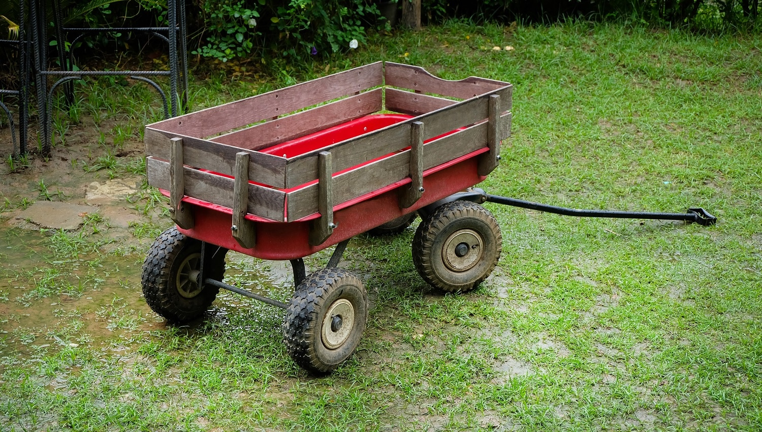 Red wagon small size on a green lawn