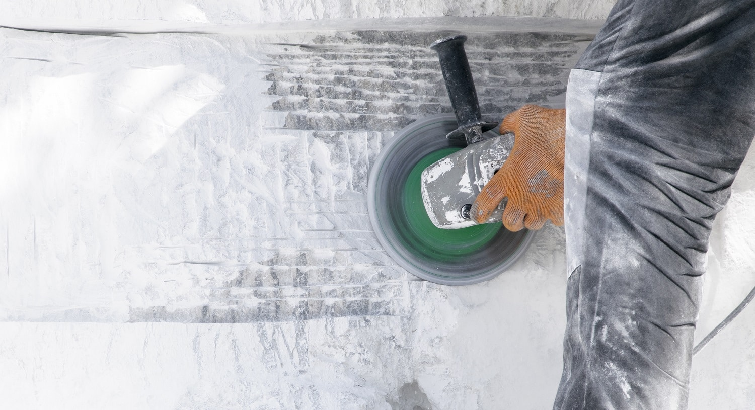 Construction work of<br /> white stone cutting by cut-off saw with diamond wheel.Close-up