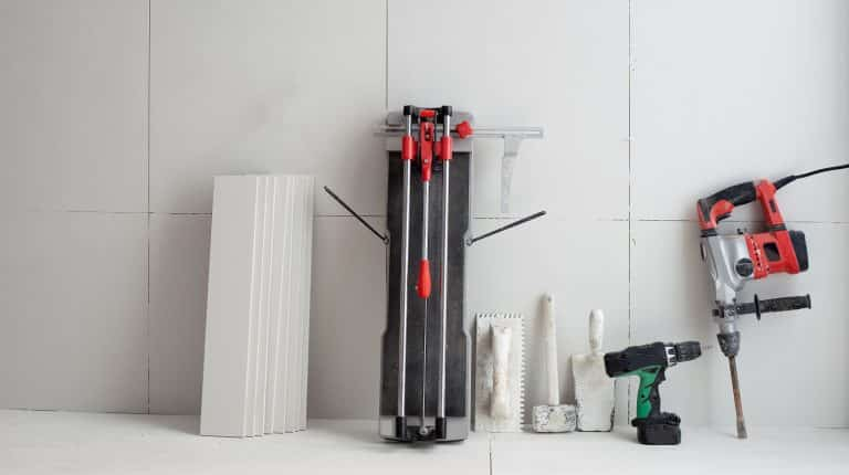construction tools as tiles cutter electric hammer drill and trowels
