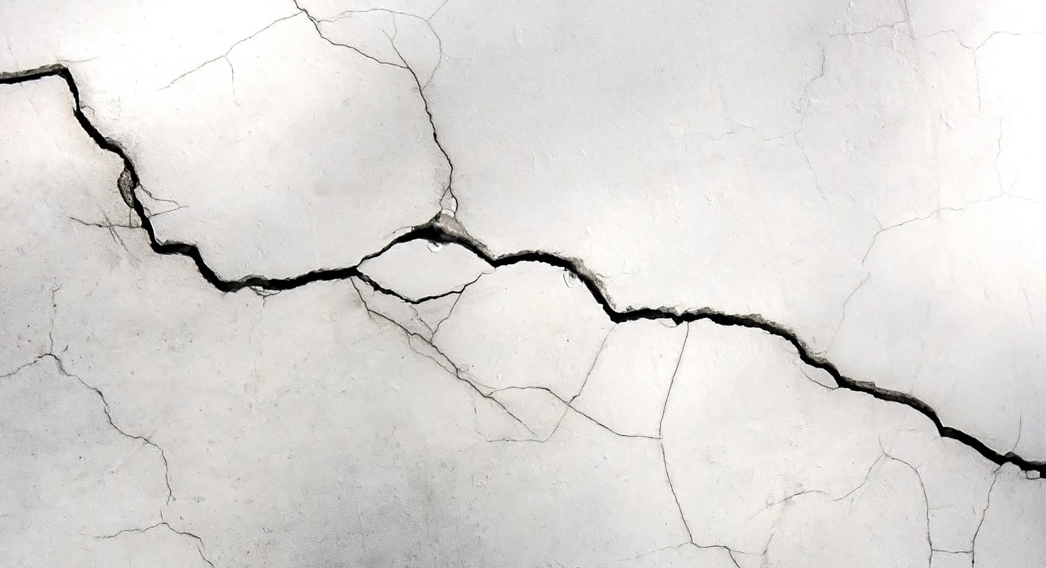 Grunge concrete cement wall with crack ,for your design and texture background