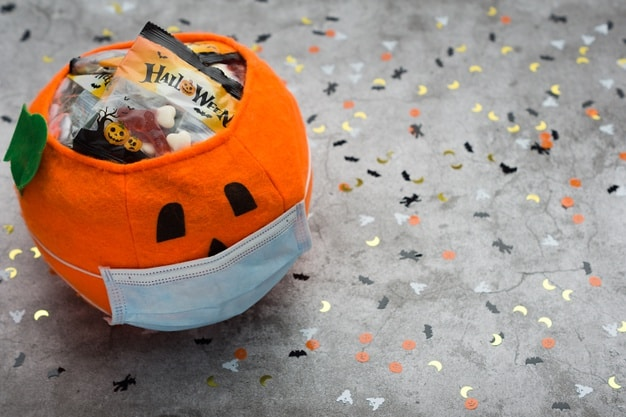 halloween pumpkin made fabric with mask filled with jelly beans decorated with halloween motifs 163068 144