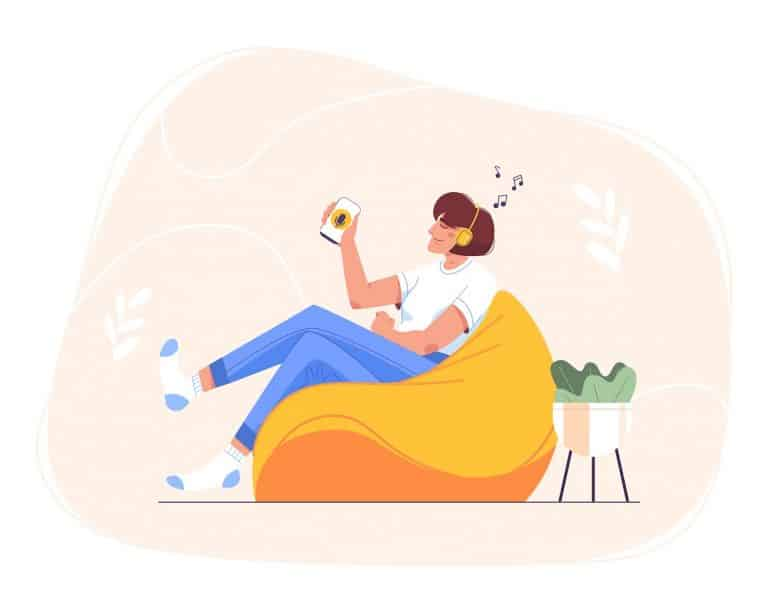 Flat happy teen girl in headphones sitting at home in bean bag chair and using smartphone for online education. Woman relaxing and listening to music, audio podcast, radio or audiobook on mobile phone