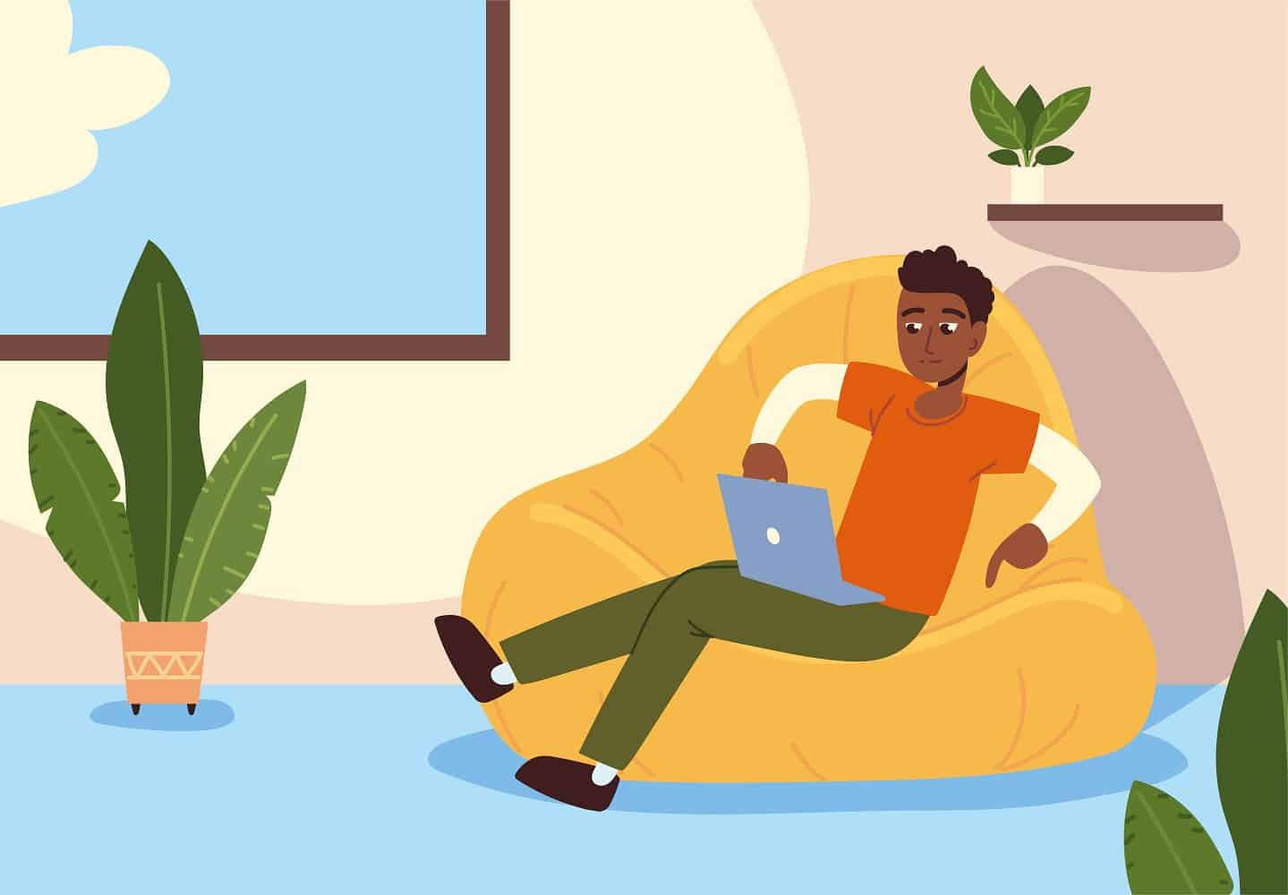 man sitting comfy bean chair with laptop