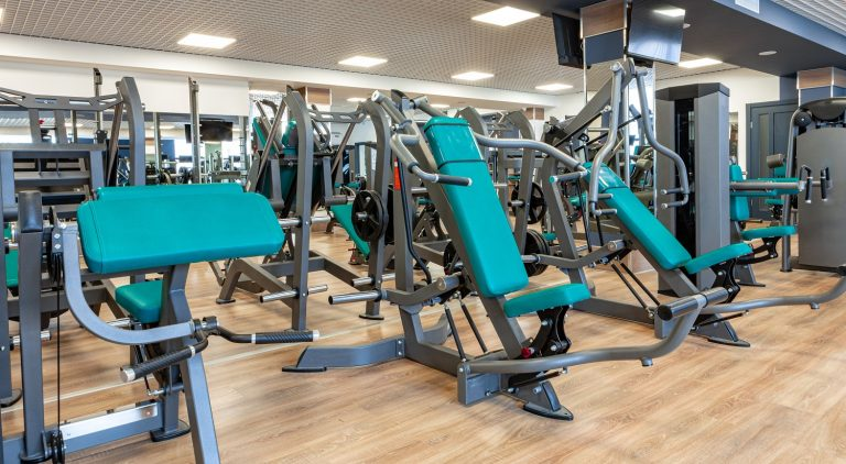New sports equipment in a gym, nobody. Background