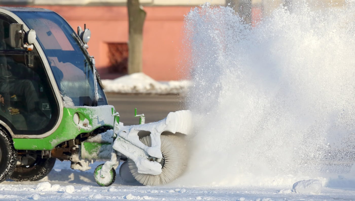 special machine for snow removal cleans the road