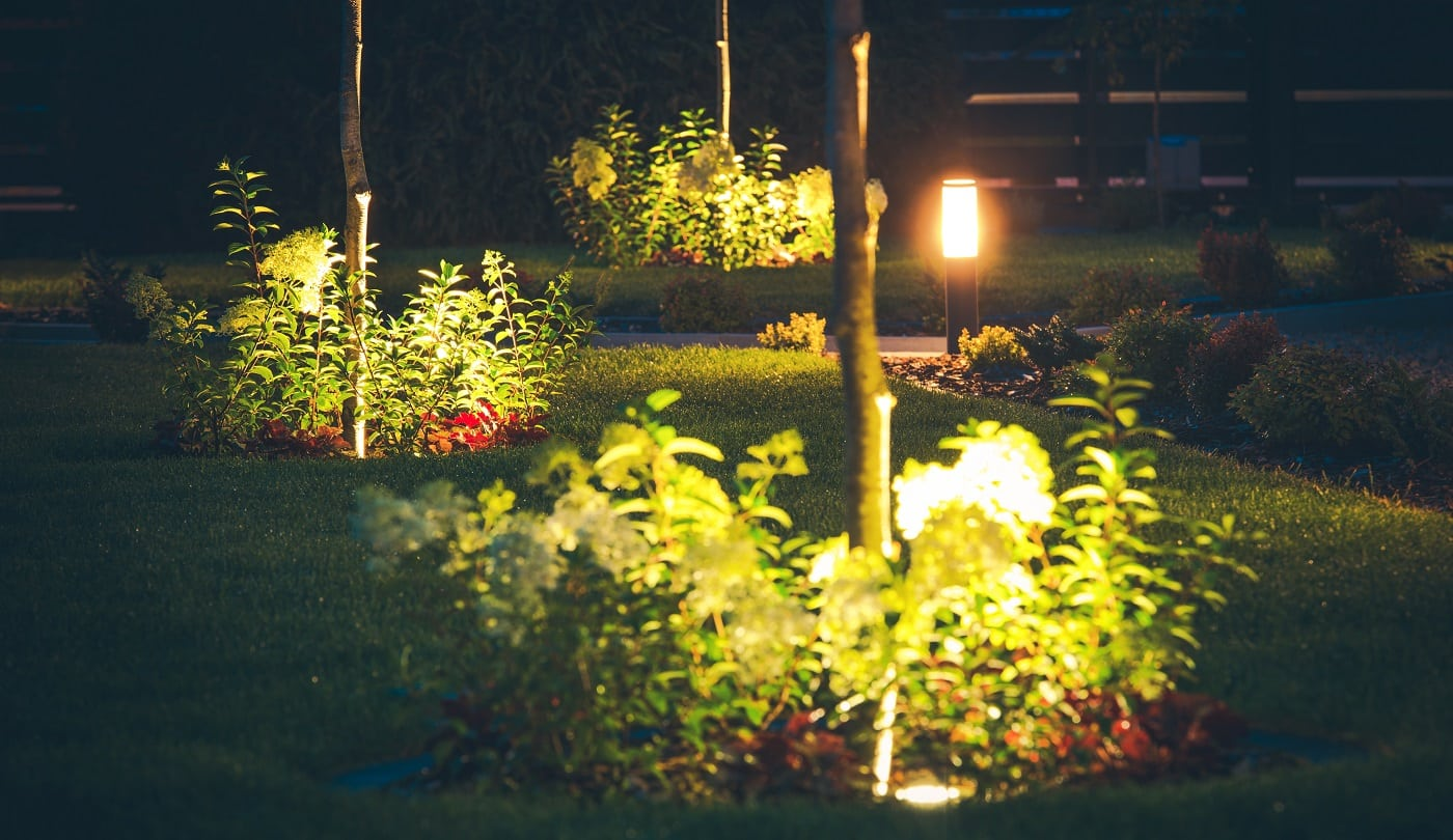 Front Yard Spotlight Illumination at Night. Elegant Lawn in Front of the House.