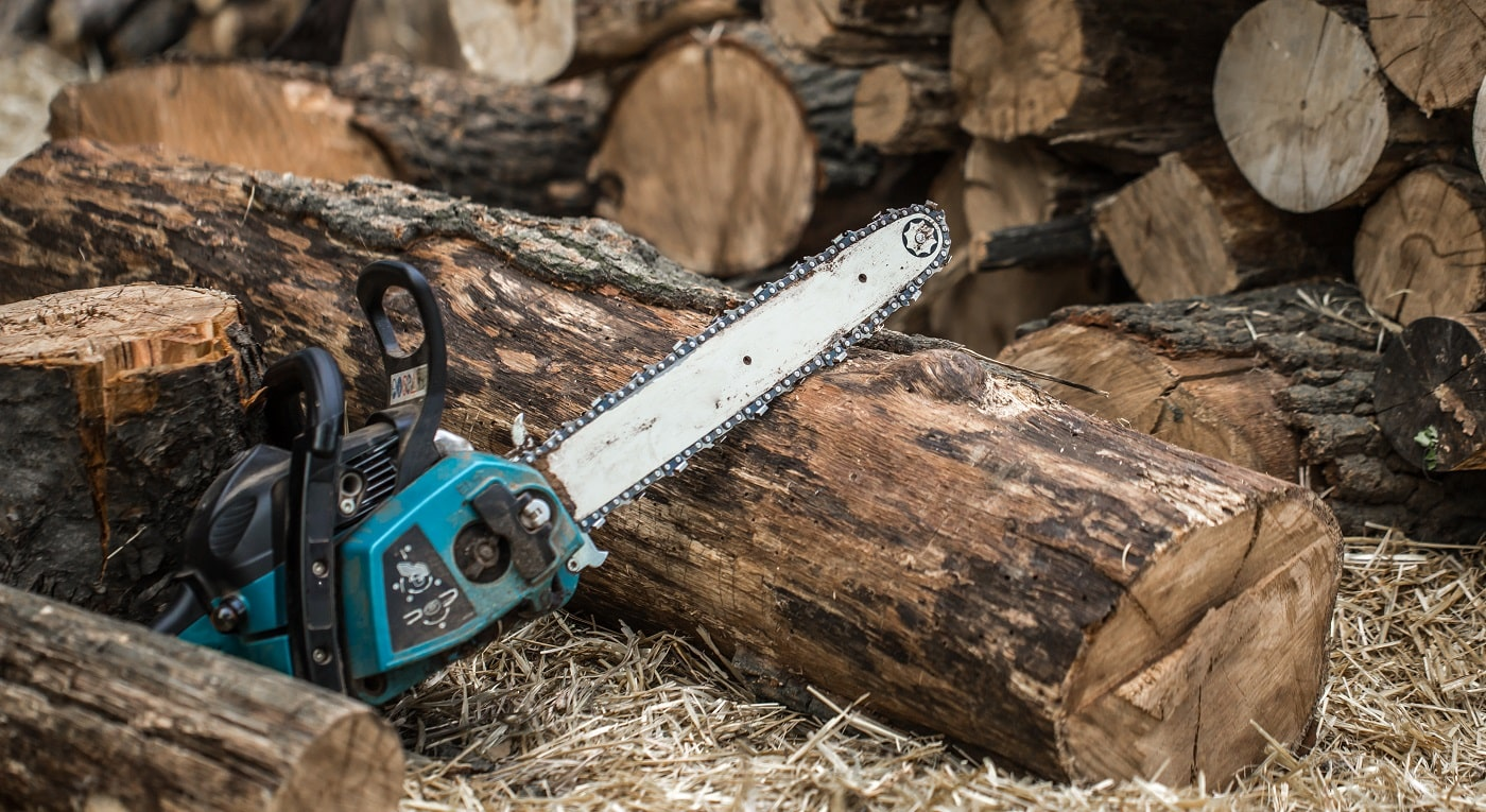 Man chopping wood with a chainsaw ,close-up