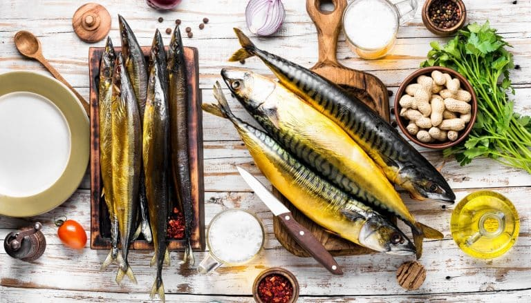 Hot smoked fresh fish.Smoked mackerel on wooden background