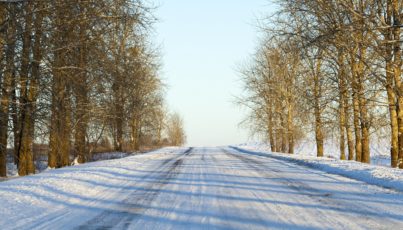small road covered with snow in the winter season, Photo close-up with a shallow depth of field