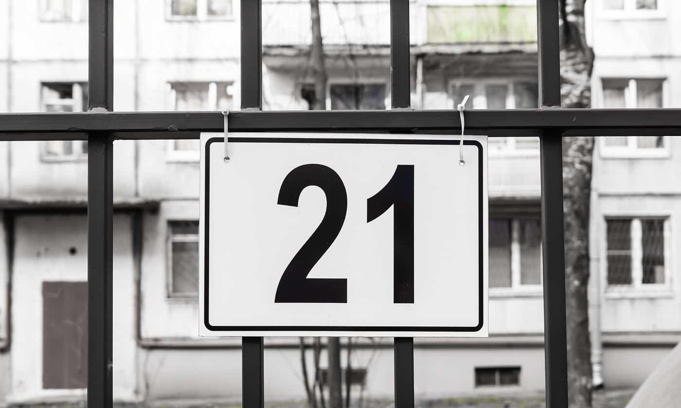 The plate with number 21 is hanging on the parking lot.