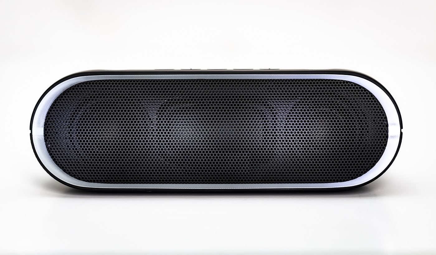 Black Bluetooth speaker with lights on isolated in white background