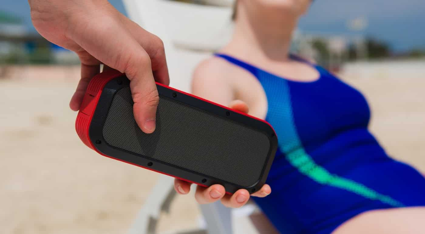 Man give to woman portable speaker