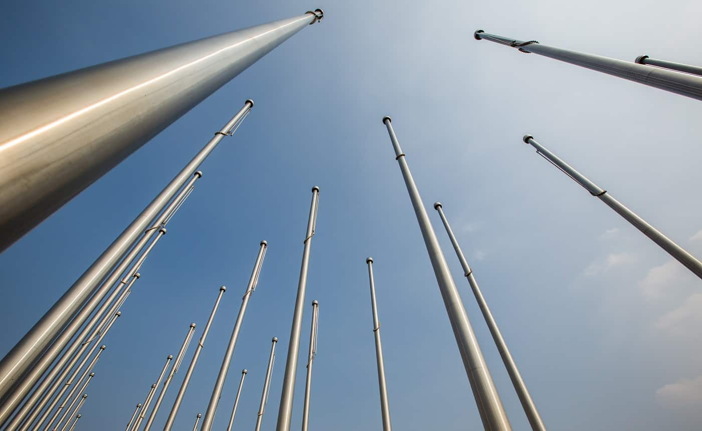 Row of flagpole in empty square,Tianjin,China.