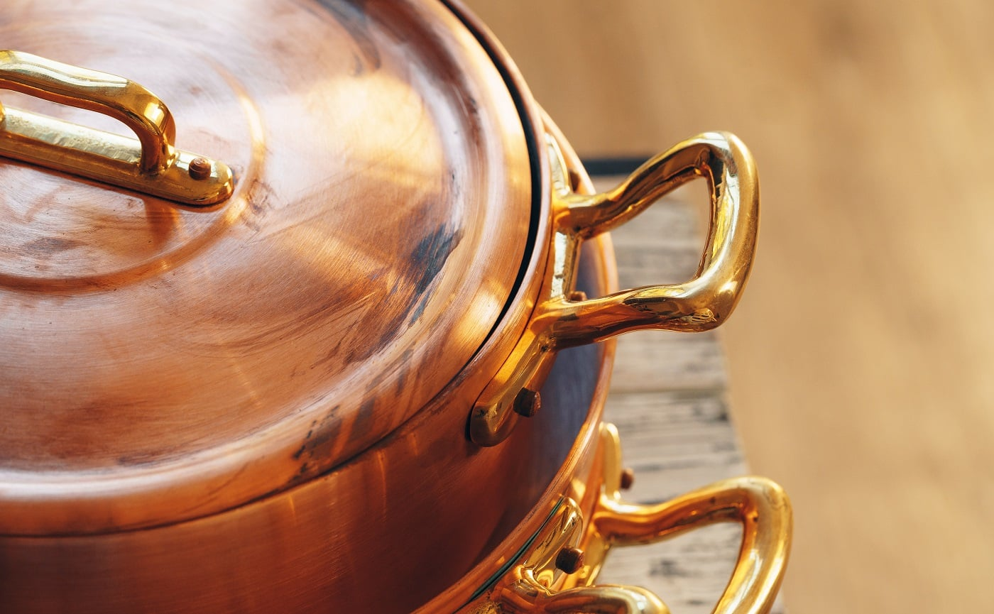 Close up of a set of copper cookware