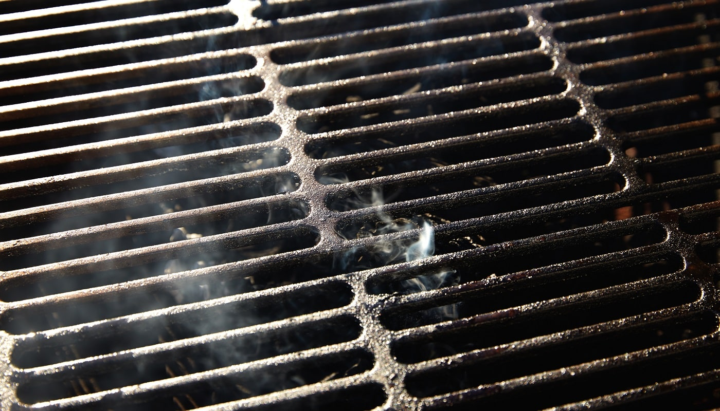 Barbecue grill texture with coal smoke macro detail