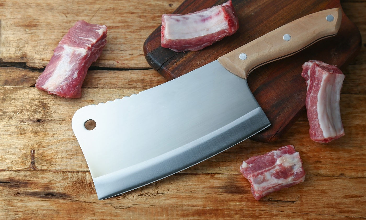 cleaver knife and ribs on wooden board