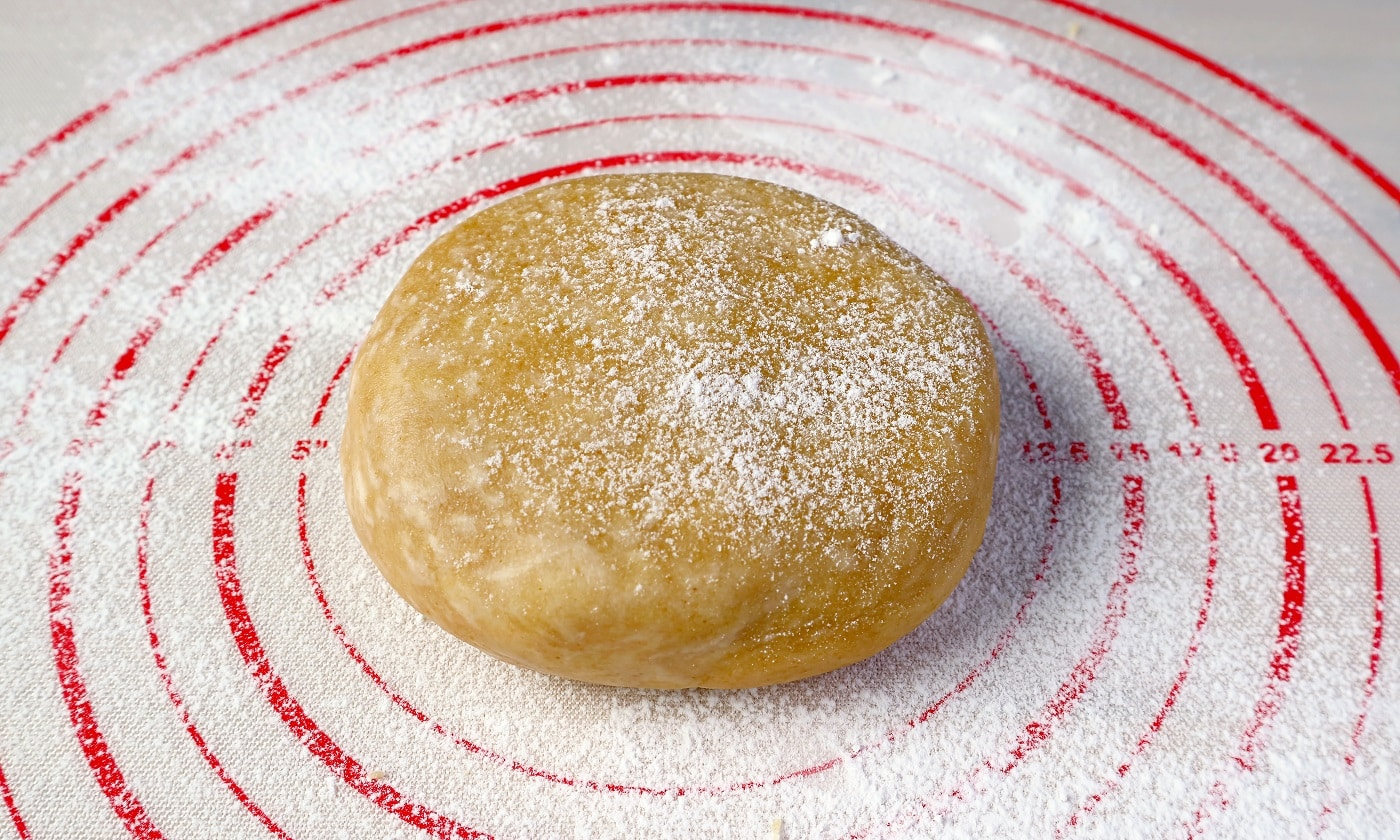 Pie dough isolated on a baking mat for the concept of baking at home