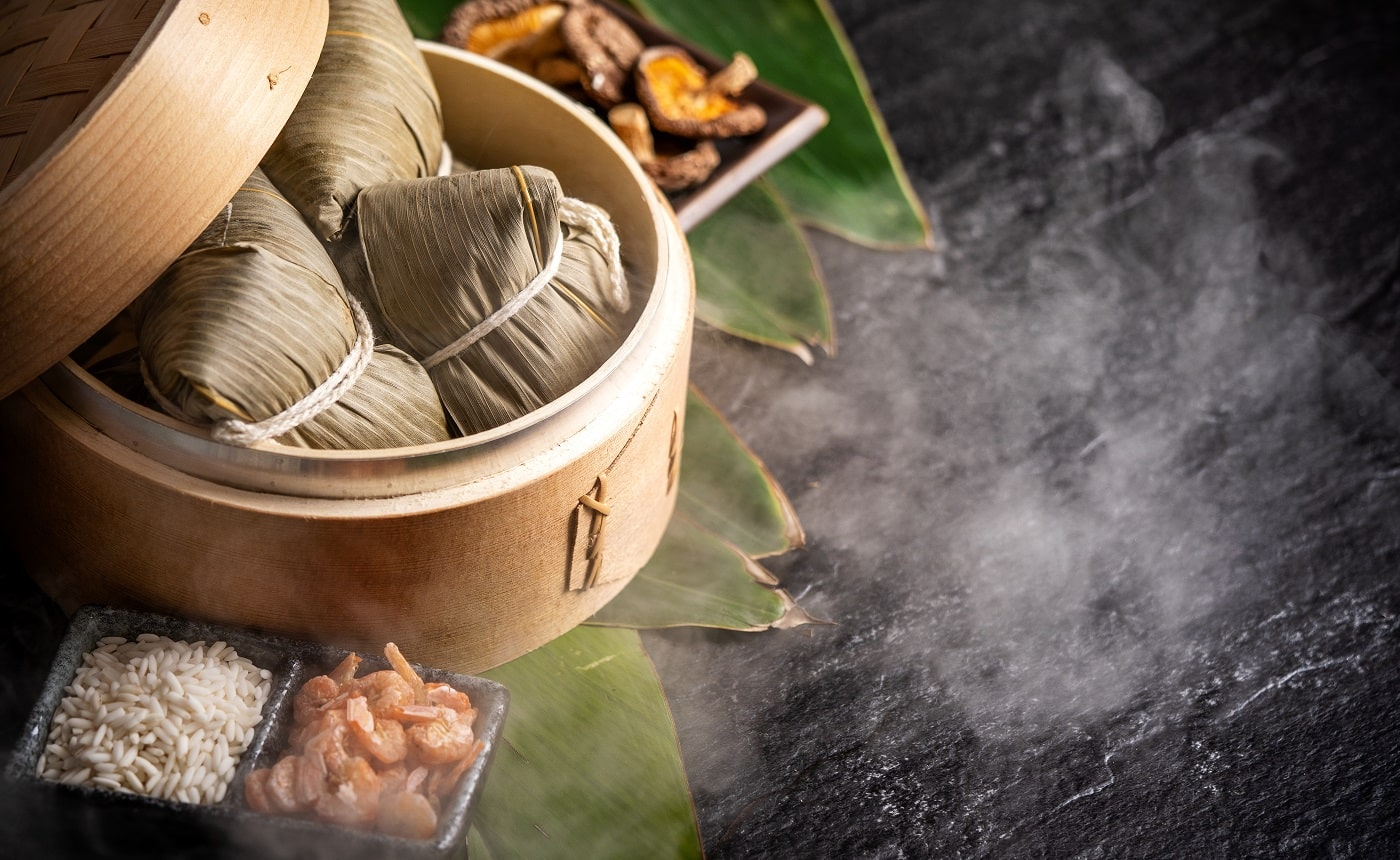 Zongzi, delicious fresh hot steamed rice dumplings in steamer. Close up, copy space, famous asian tasty food in dragon boat duanwu festival