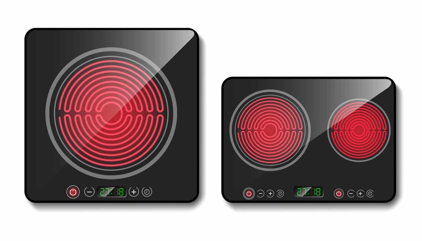 Vector realistic black induction cooktops or glass-ceramic cooking panels, hobs with one and two heating zones, isolated on background. Modern stove for cooking food with touch control buttons