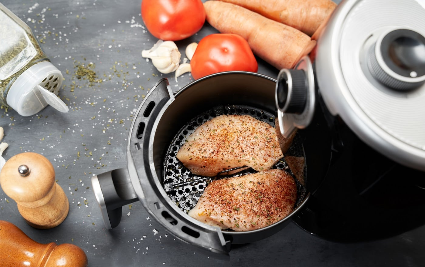 Cooking skinless chicken breast with spices in an air fryer