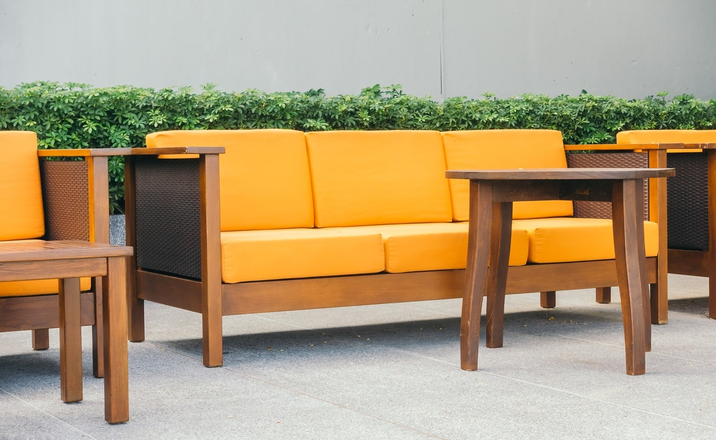 Wooden sofa and chair with outdoor patio