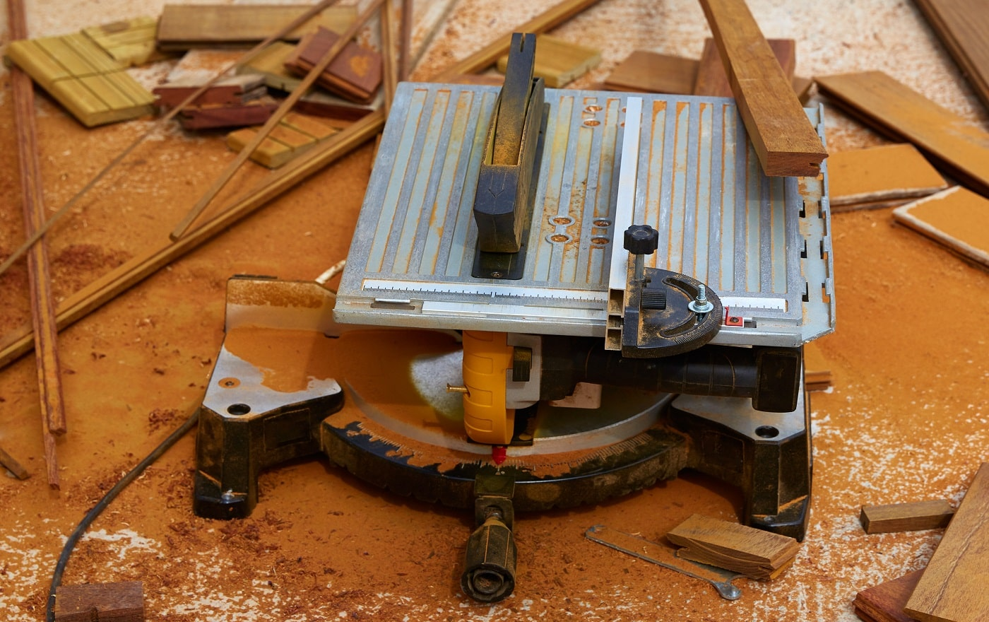 Circular table saw carpenter tool and sawdust in deck installation