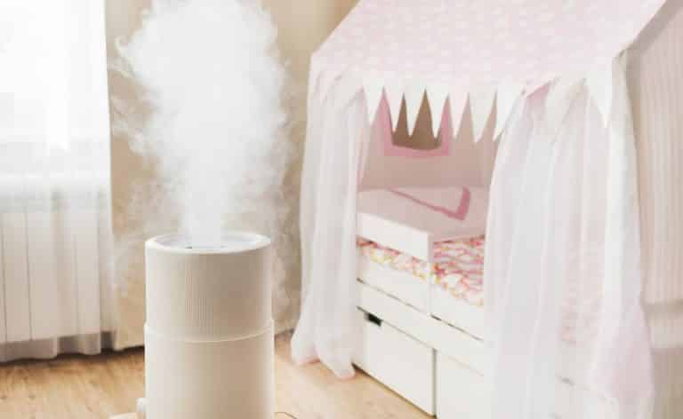 Modern air humidifier in children's room, aroma oil diffuser at home. Improving the comfort of living in a house, Improving the well-being. Baby care.