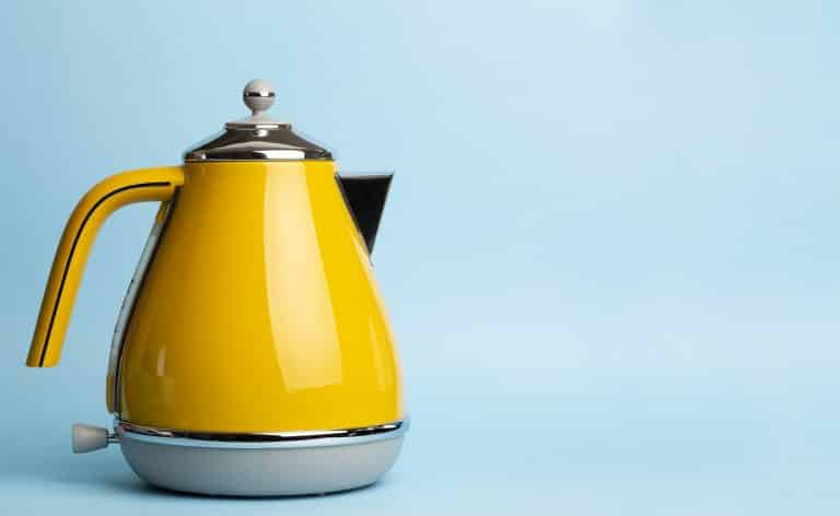 Kettle Background. Electric vintage retro kettle on a colored blue background. Lifestyle and design concept.