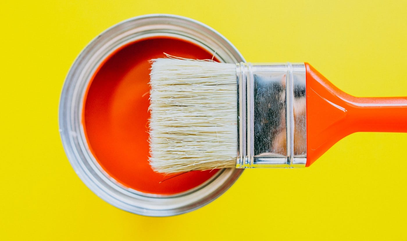 Paint can with paint brush for repairs isolated
