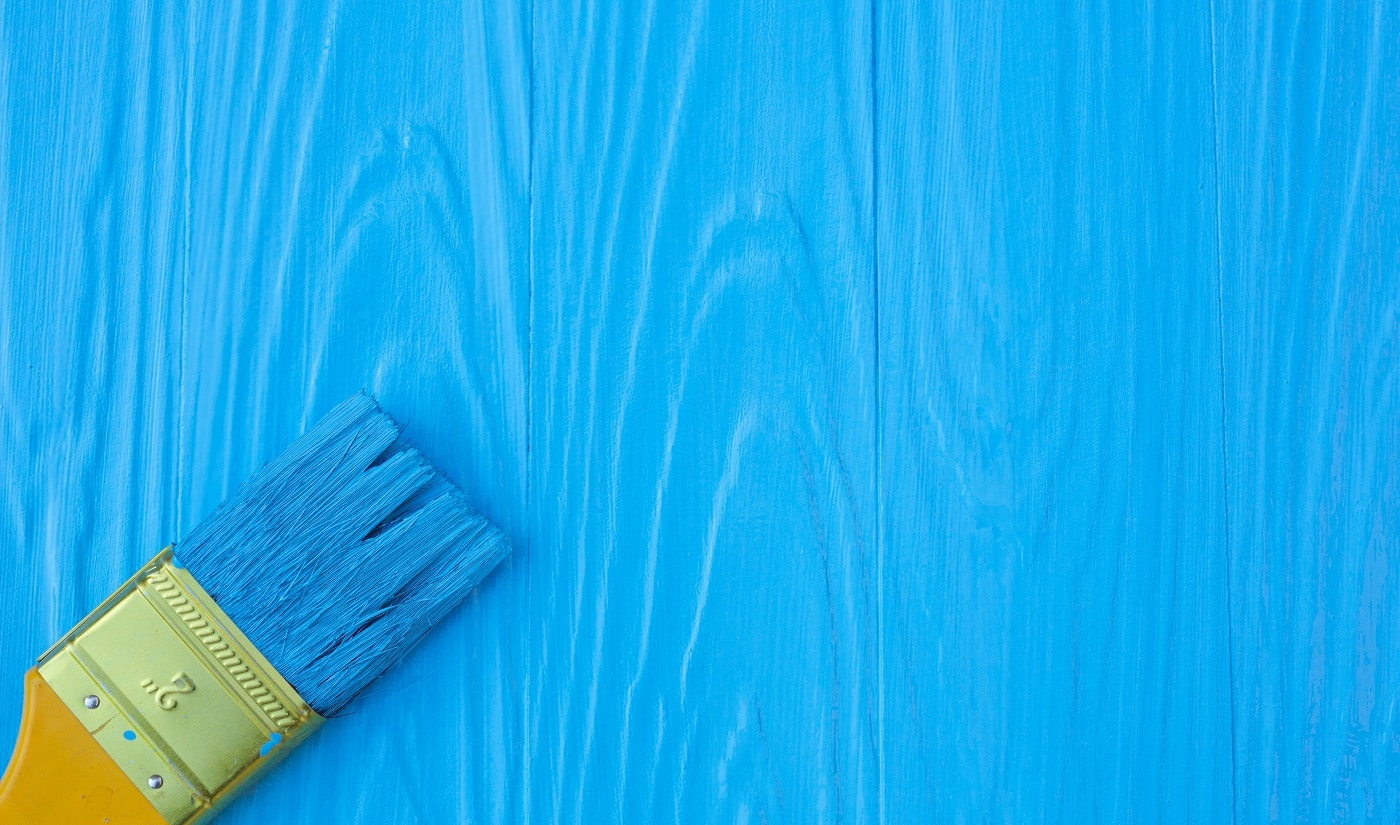 A brush painted on a blue background.