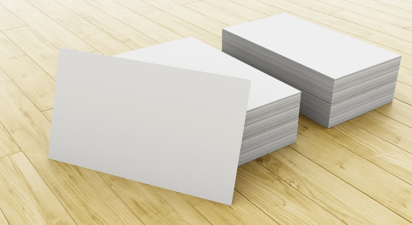 3d illustration. Stack of blank business cards on wooden table. Mock up for your design