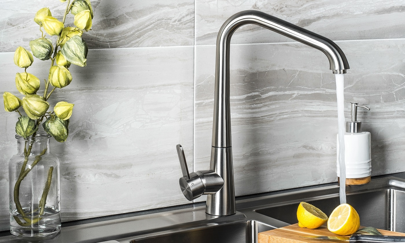 The new and modern steel faucet in the kitchen