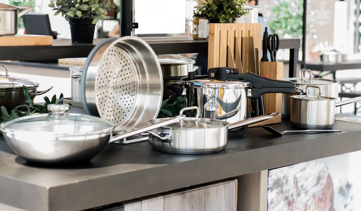 Stainless steel kitchenware on the table