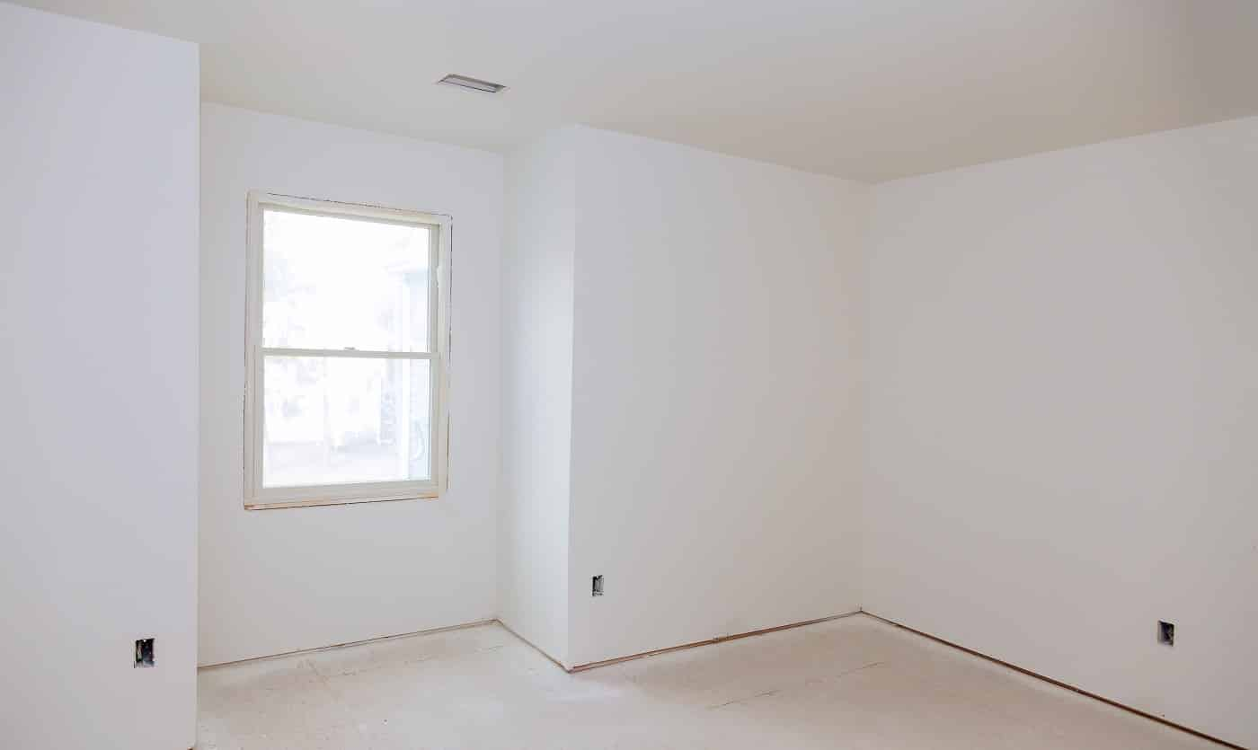 Interior construction of housing of empty apartment with white wall