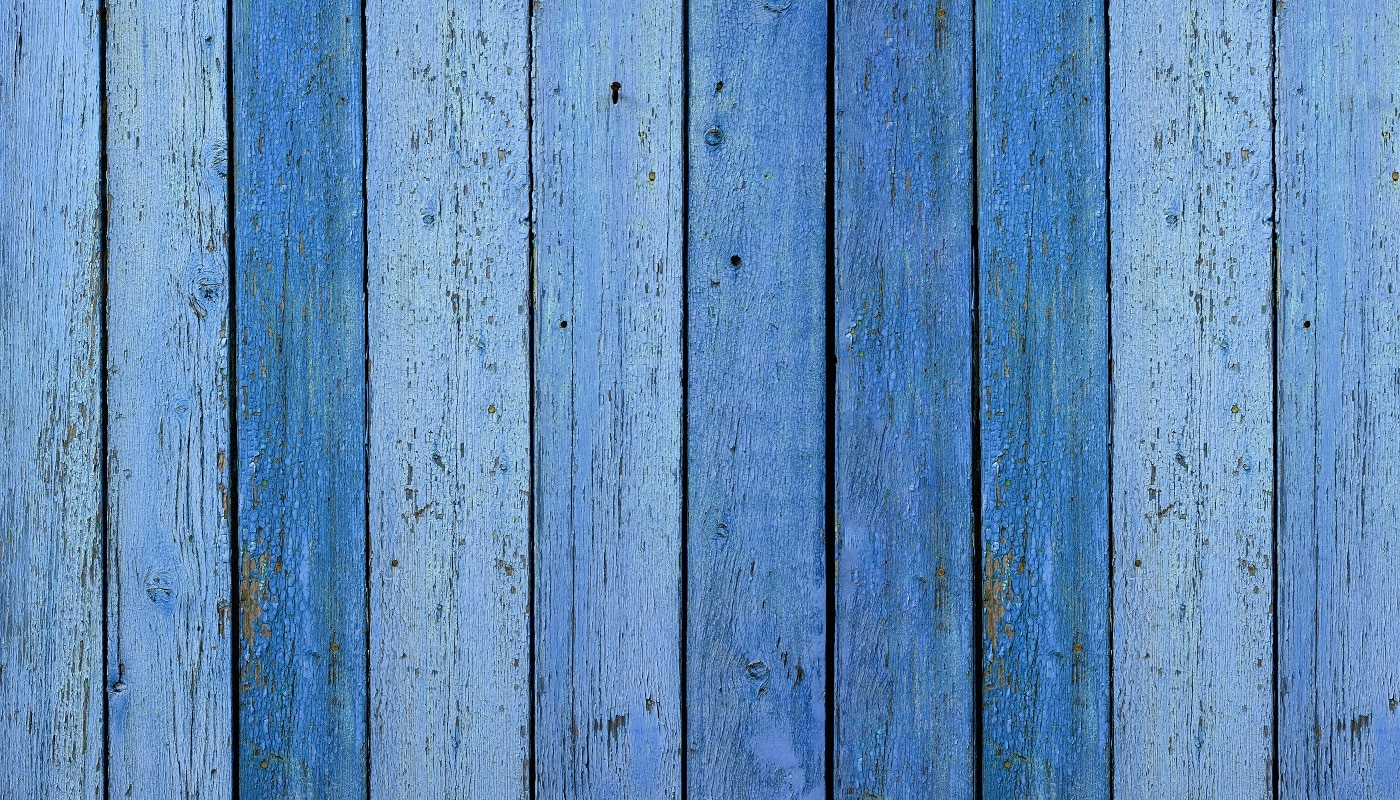 blue very old painted boards with peeling and cracked paint. Abstract vintage backdrop, banner
