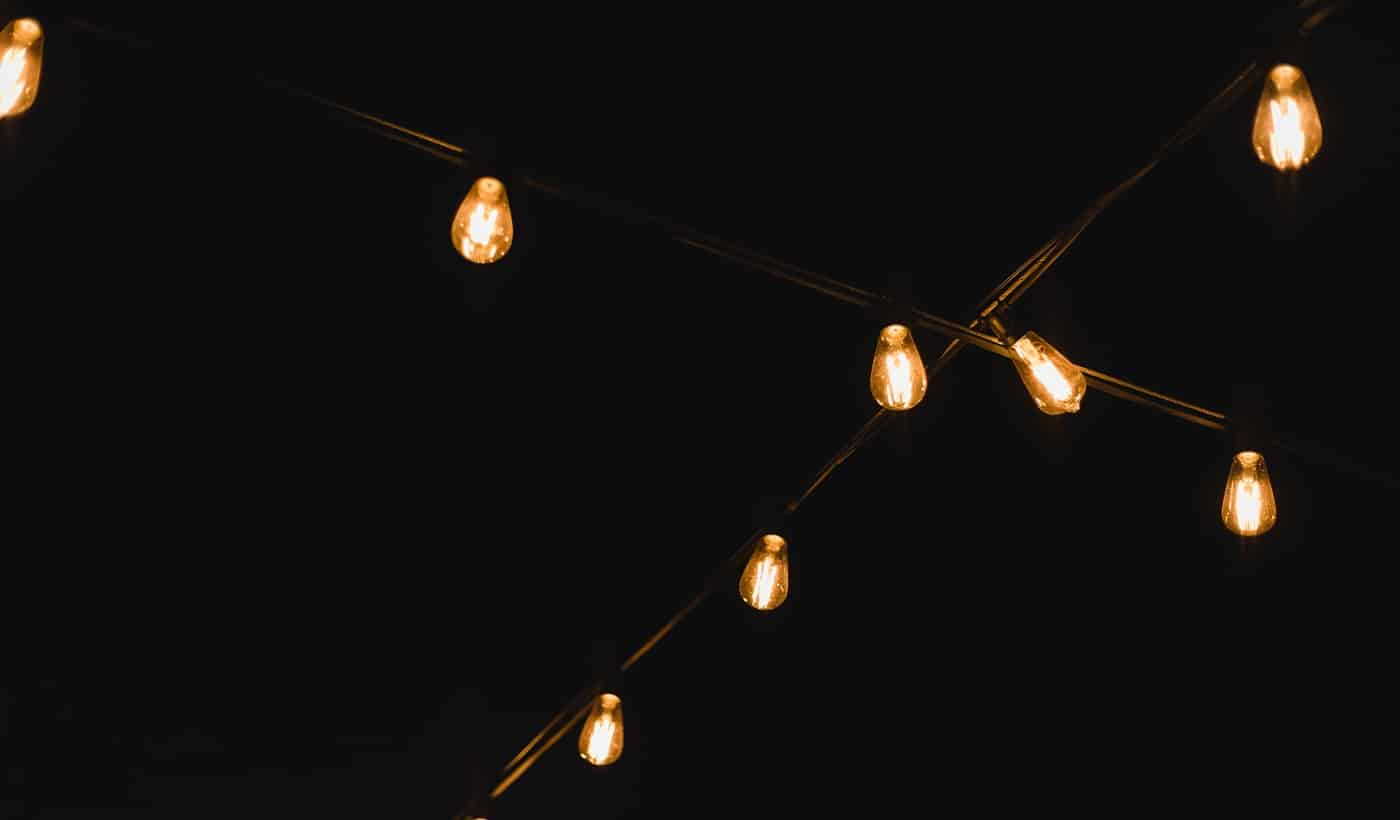 Light bulb decor in outdoor party. Decorative outdoor string lights at night time