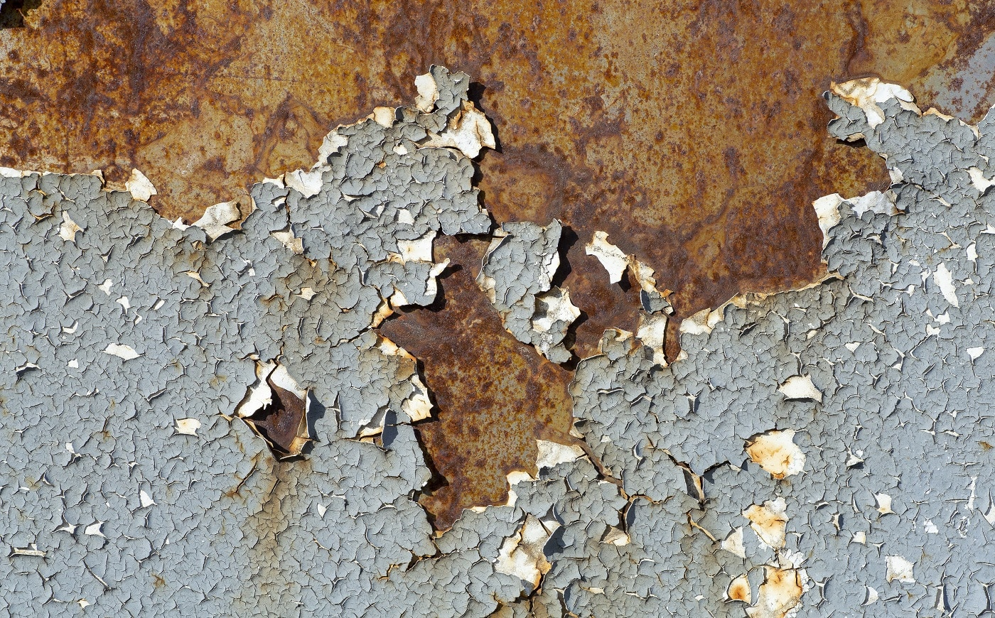 Old paint background. Texture and pattern of peeling dried old paint on the wall. Old painted wall background.