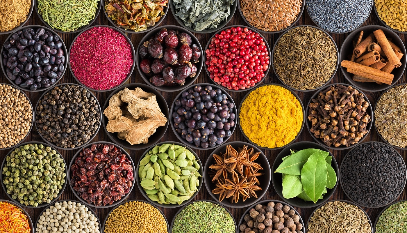 Bright spice background, top view. Collection seasoning and herbs of Indian food