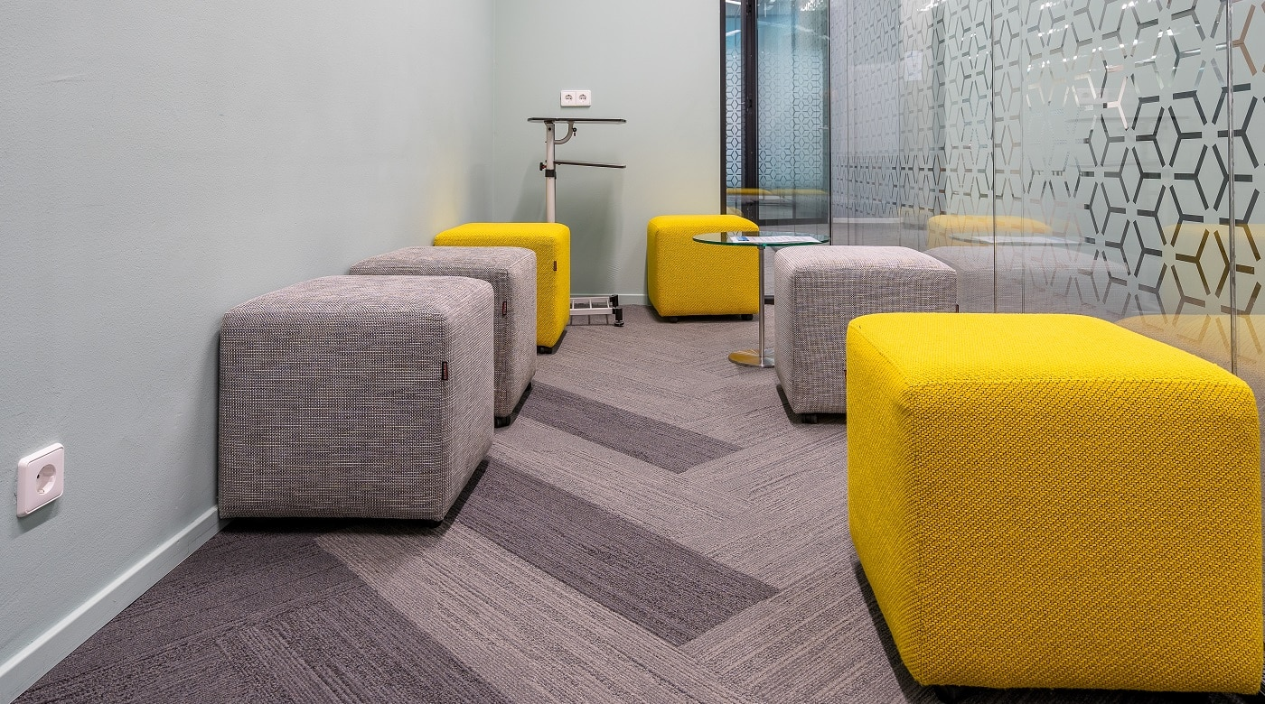 A corner of the open office space with a modern interior design