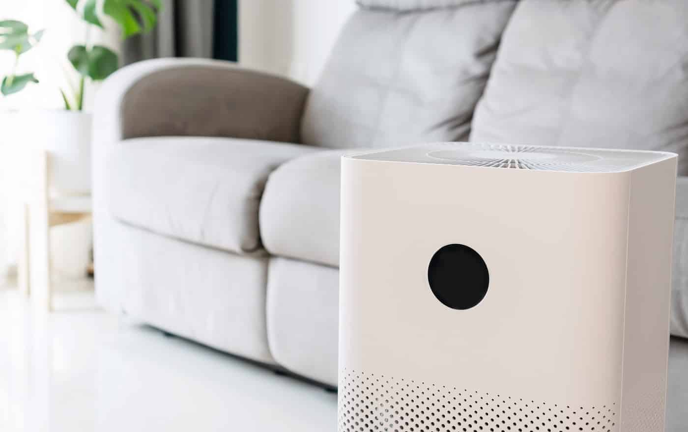 Closeup of air purifier in living room for wellbeing breathing fresh air while dust air pollution situation outside is really bad. PM 2.5, healthy concept