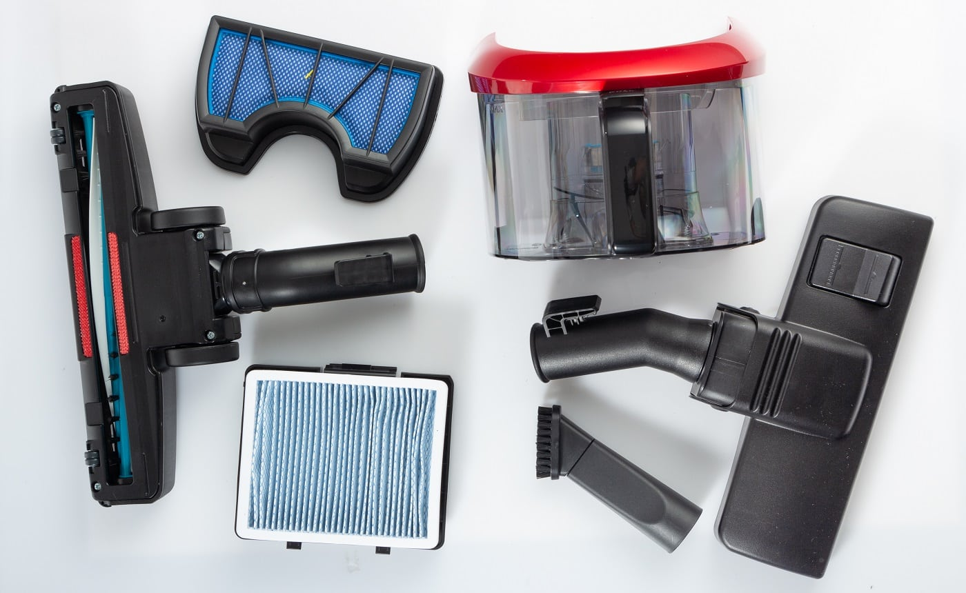 Vacuum cleaner accessories, filters, brush nozzles on a white background, spare bristles for cleaning.