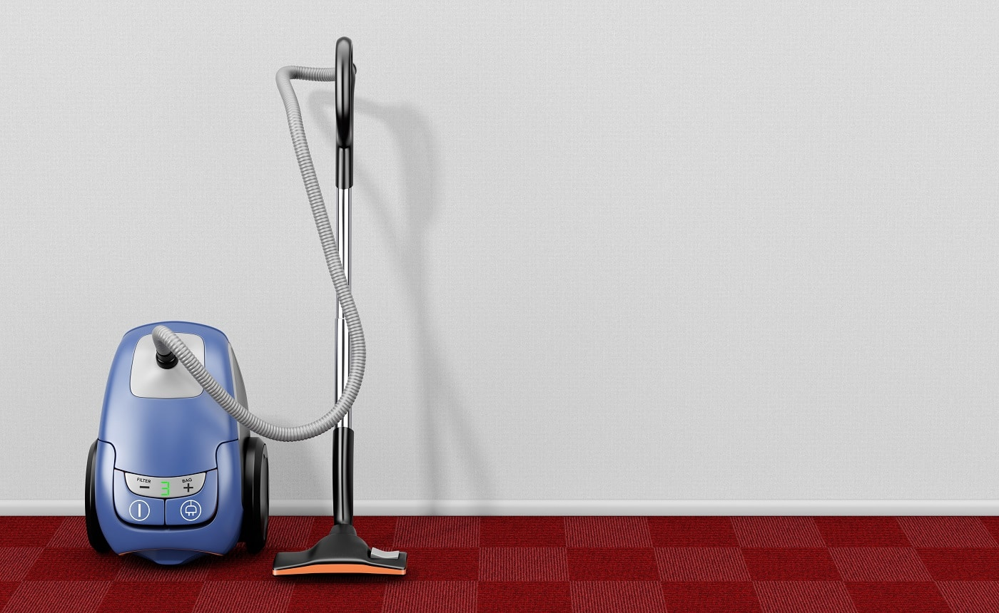 Home Appliance Concept. Modern Vacuum Cleaner in Empty Living Room with Red Carpet extreme closeup. 3d Rendering.