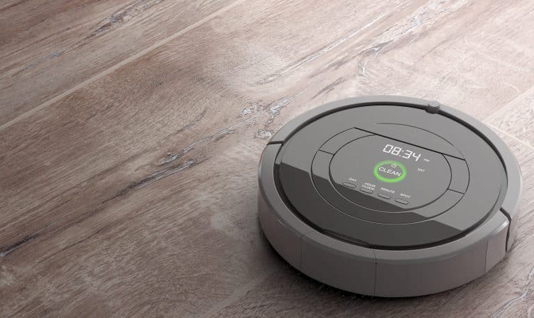 New Cleaning Technology Concept. Smart Robotic Vacuum Cleaner on a wooden floor. 3d Rendering